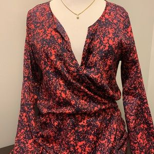 Red and navy faux wrap dress button cuff detail
